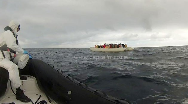 This handout video grab released by the Italian Coast Guard shows a rescue operation of migrants off the coast of Sicily on February 14, 2015/AFP