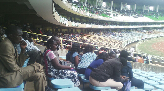 Thousands of Kenyans are sitting silently inside the stadium while others are outside mostly in small groups murmuring/FILE