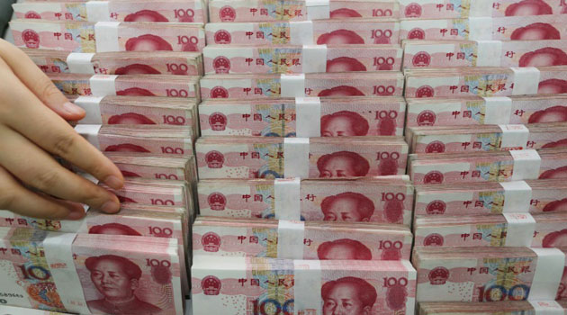 The cut was less than previous two days and came after reports the People's Bank of China (PBoC) intervened Wednesday to stem the yuan's fall/AFP