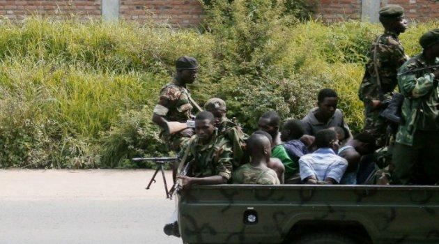 A military vehicle, carrying men tied up, drives through the Musaga neighbourhood of the city of Bujumbura/AFP