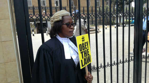 FEMALE-LAWYER-SIGN