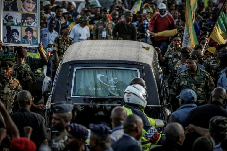 Mourners lined the streets of Soweto as the hearse carrying the body of the anti-apartheid icon returned to her home