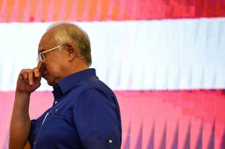 Former Malaysian PM Najib Razak and his wife banned from leaving country