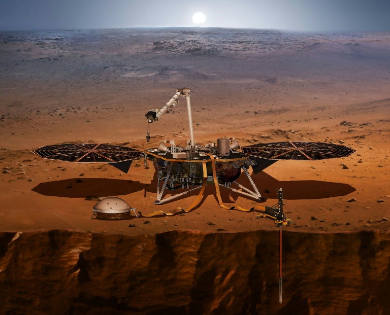 The In Sight lander seen here in a NASA handout illustration is designed to monitor quakes on the surface of Mars