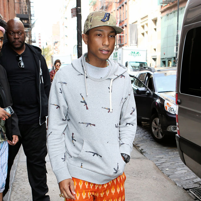 Singer and fashion designer Pharrell Williams leaves the Mercer Hotel in New York City