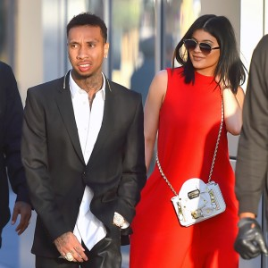 Kylie Jenner and Tyga walk arm and arm to a movie date in downtown los angeles. kylie wore a red dress and toga wore leather pants Pictured: Kylie Jenner and Tyga Ref: SPL1049068  090615   Picture by: Fern / Splash News Splash News and Pictures Los Angeles:310-821-2666 New York:	212-619-2666 London:	870-934-2666 photodesk@splashnews.com