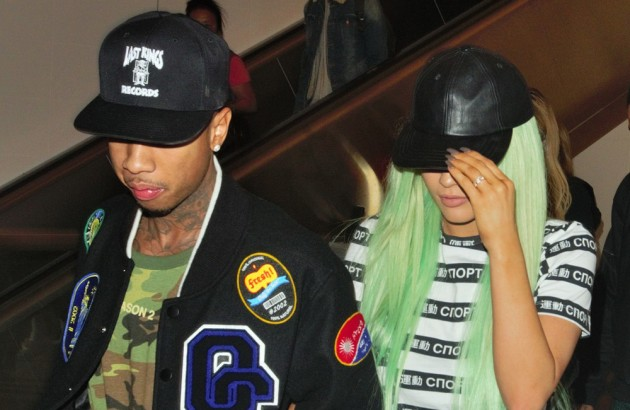 Kylie Jenner arrives to Los Angeles airport with her boyfriend Tyga Pictured: Kylie Jenner and Tyga Ref: SPL1128622 170915 Picture by: Holly Heads LLC / Splash News Splash News and Pictures Los Angeles:310-821-2666 New York: 212-619-2666 London: 870-934-2666 photodesk@splashnews.com