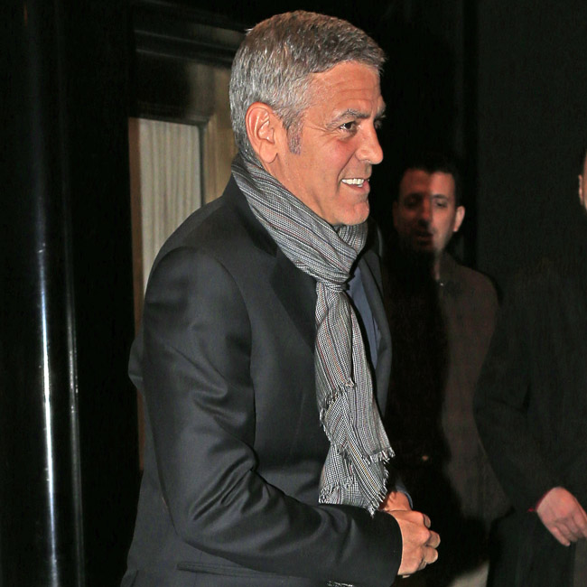 George Clooney exits the Carlyle hotel on the way to dinner in New York City
