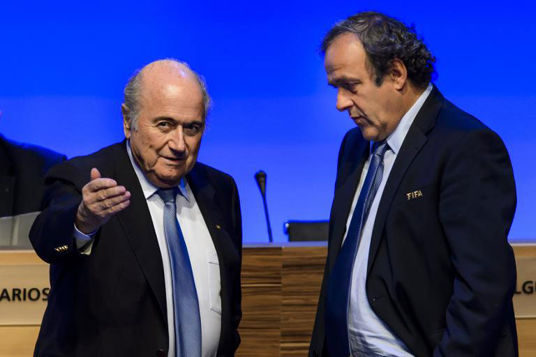 Outgoing FIFA president, Sepp Blatter and UEFA boss, Michel Platini (right). PHOTO/File
