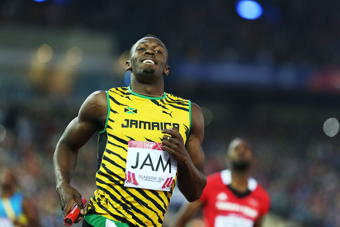 Usain Bolt competes in the 4x100m Relay at last year's Commonwealth Games in Glasgow. PHOTO/FILE