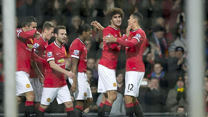 Maroune Fellaini (second right) celebrates scoring for United in a past match. PHOTO/File