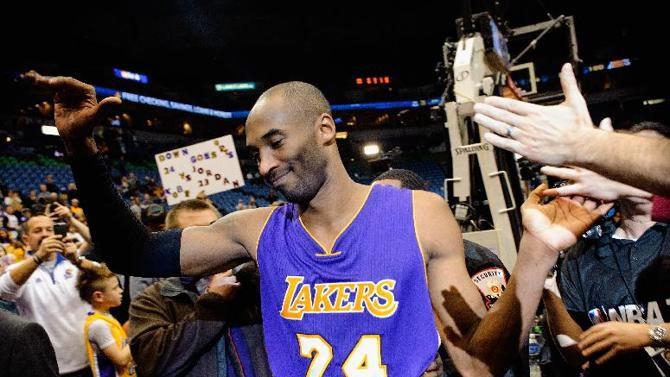 Kobe Bryant greets fans at a previous LA Lakers game. PHOTO/File
