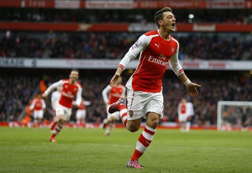 Mesut Ozil celebrates scoring for his club Arsenal. PHOTO/File