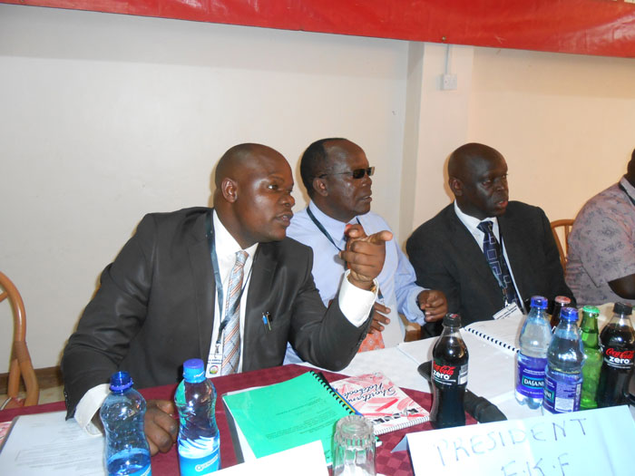 KFK Vice-president Robert Asembo (left) and President Sam Nyamweya (centre) in a NEC meeting in Eldoret. The two have been urged to quit the federation by NEC member Tom Alila.