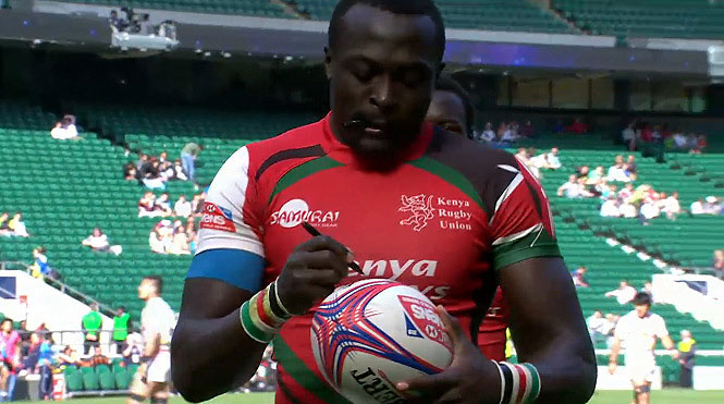 Collins Injera autographs the ball he grounded for his 200th World Series try. PHOTO/File