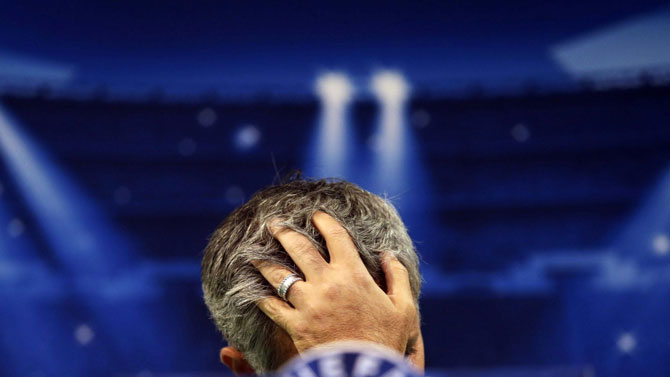 Under pressure Chelsea manager, Jose Mourinho, bows his head at a press conference. PHOTO/File