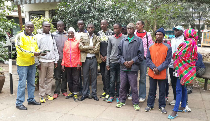 Athletes who took part at the Lari and Great Green races in Kiambu County outside Nairobi's Hilton Hotel after organisers disappeared on them. PHOTO/Alex Isaboke