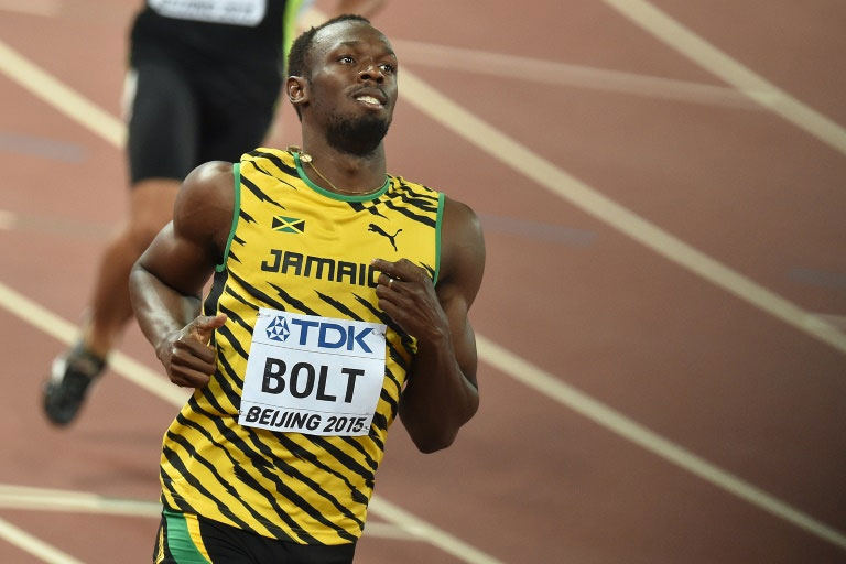 Men's 100m sprint defending champion Usain Bolt of Jamaica steamed home in a very comfortable 9.96 seconds at the world athletics championships in beijing on August 22, 2015. PHOTO/AFP