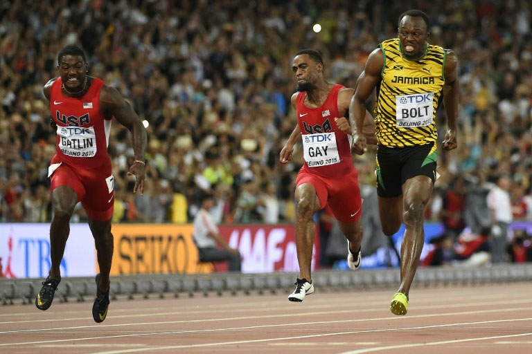 Usain Bolt (right) outpaces Justin Gatlin (left) and Tyson Gay to win the men's 100m in Beijing. PHOTO/AFP