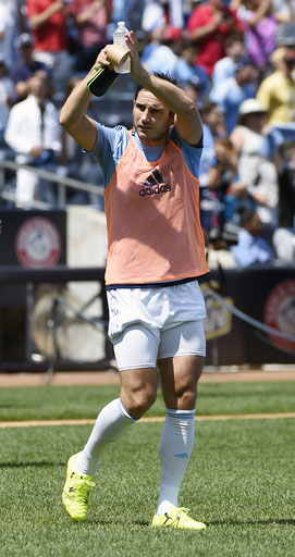 Frank Lampard, newly acquired player for New York City FC, acknowledges the applause of fans as he enters the field before asoccer game against the Montreal Impact at Yankee Stadium, Saturday, Aug. 1, 2015, in New York.