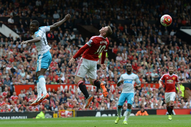 Wayne Rooney jumps for the ball Manchester United's match against Newcastle United at Old Trafford, on August 22, 2015. PHOTO/AFP