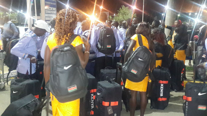 Members of Team Kenya prepare to check-in for their flight to Beijing on Monday night. PHOTO/ALEX ISABOKE