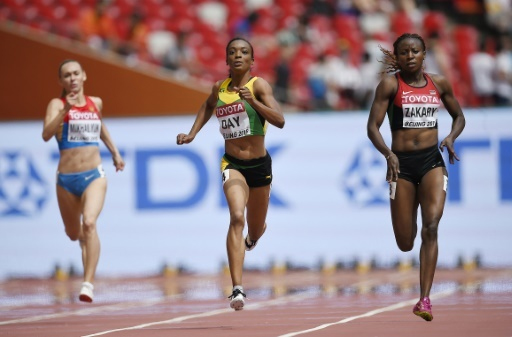 Joy Zakari (right) when she won her women 400m heat at the Beijing Worlds before being suspended for doping. PHOTO/IAAF/Getty Images
