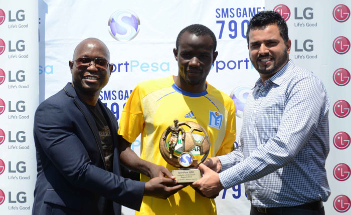 Muhoroni Youth forward, Dennis Mandela, receives the SJAK/SportPesa Player of the Month Award for August in Kisumu on September 15,2015. PHOTO/AFP