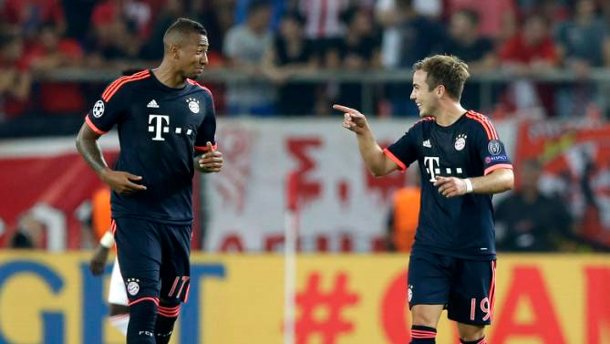 Bayern's Mario Goetze, right, celebrates with is teammate Jerome Boateng after scoring his side's second goal during the Champions League Group F soccer match between Olympiakos and Bayern Munich at Georgios Karaiskakis stadium in Piraeus port, near Athens, Wednesday, Sept. 16, 2015. PHOTO/AP/Yahoo!