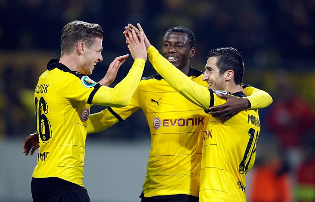 Borussia Dortmund players celebrate a goal against Paderbon as the Bundesliga giants ran riot in the German Cup. PHOTO/EFE