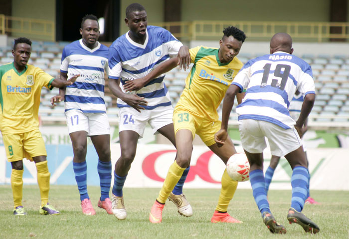 Mathare United's Edwin Lavatsa tries to escape the attention of AFC Leopard's Solomon Nasio (#19) and Israel Emuge (third right) during their SPL clash on Sunday, October 18, 2015. PHOTO/Raymond Makhaya