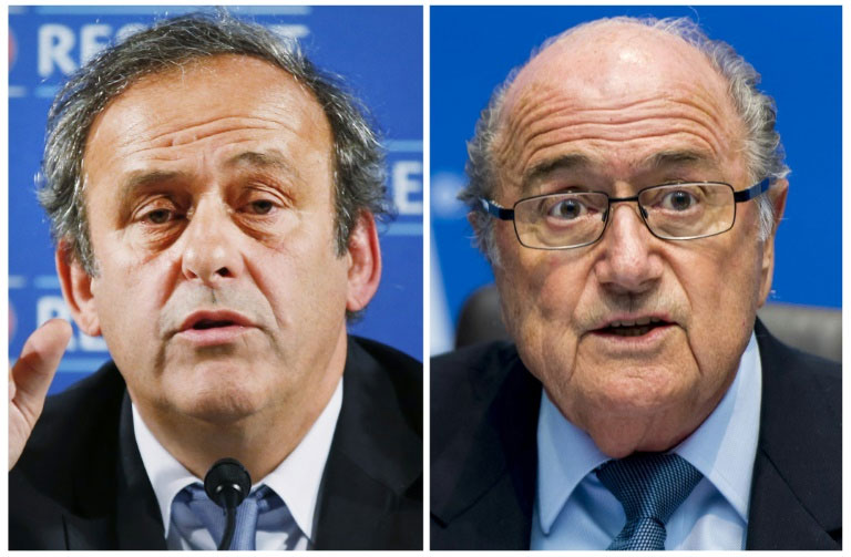 Evidence has emerged that FIFA President Sepp Blatter (R) made a murky $2 million payment to UEFA President Michel Platini in 2011, reportedly for work done a decade earlier . PHOTO/AFP