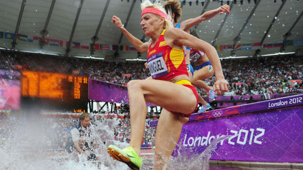 Spain's Marta Dominguez (foreground) on her way to win the women steeplechase title. Milka Chemos (right, partly hidden) won bronze on the day. PHOTO/Omni Sport
