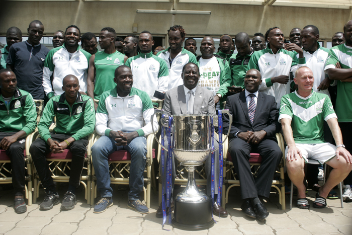 Former Prime Minister, Raila Odinga, poses with the SPL Trophy when he hosted Gor Mahia to luncheon after holding on to their title in November. PHOTO/Raymond Makhaya