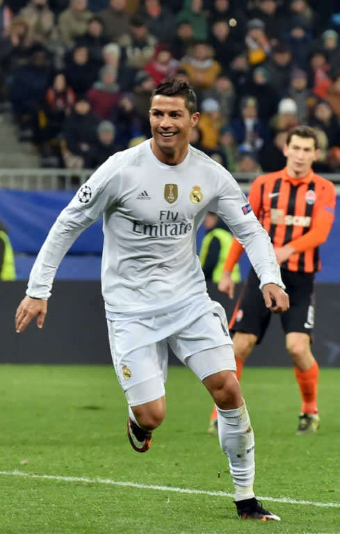 Real Madrid's forward Cristiano Ronaldo celebrates after scoring during a UEFA Champions League match against Shakhtar Donetsk in Lviv on November 25, 2015. PHOTO/AFP