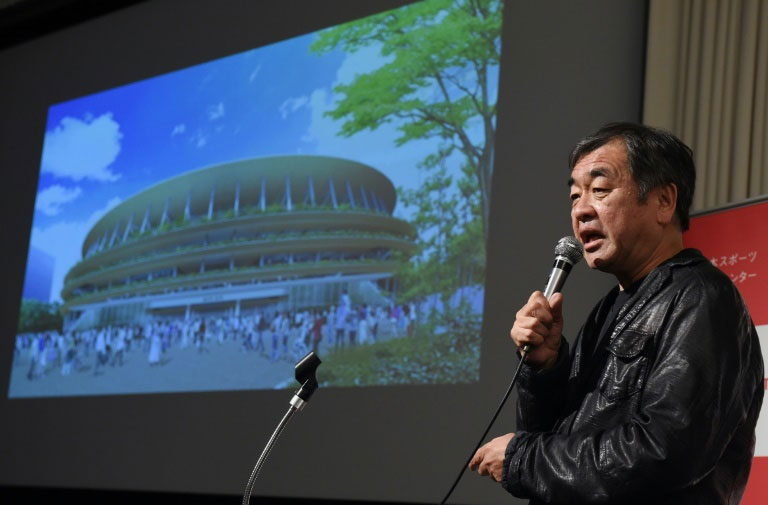 Architect Kengo Kuma explains his design of the 2020 Olympic Stadium during a press conference announcing the new design, in Tokyo on December 22, 2015. PHOTO/AFP