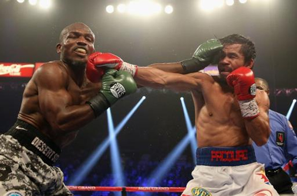 Timothy Bradley and Manny Pacquiao trade punches at the MGM Grand Garden Arena on April 12, 2014 in Las Vegas, Nevada