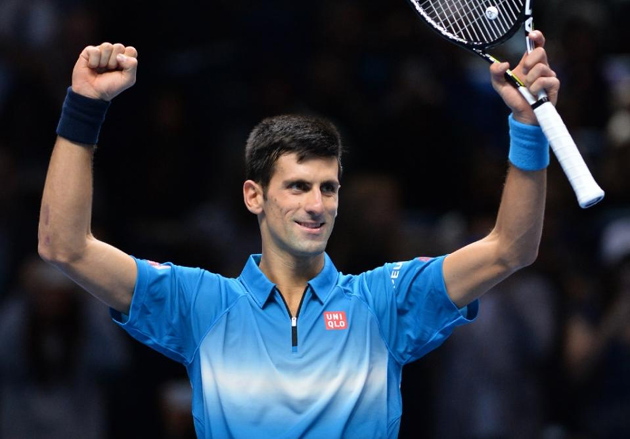 Novak Djokovic celebrates after beating Roger Federer to claim the ATP World Tour Finals title in London, on November 22, 2015 (AFP Photo/Glyn Kirk)