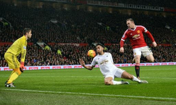 Manchester United's striker Wayne Rooney (R) scores his team's second goal during an English Premier League football match against Swansea City at Old Trafford on January 2, 2016
