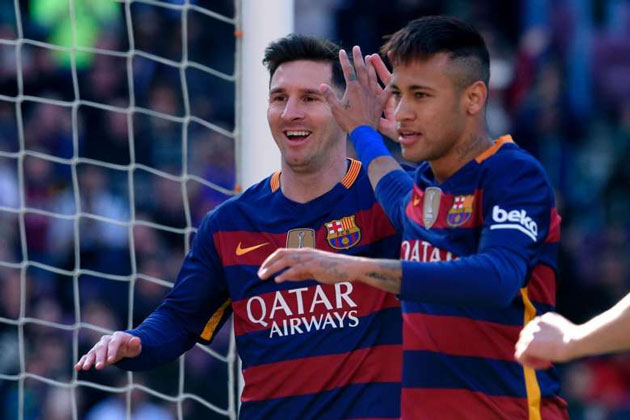 Messi (left) and Barcelona's Brazilian forward Neymar celebrate an Getafe own goal.PHOTO: AFP
