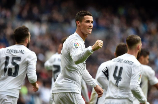 Real Madrid's Portuguese forward Cristiano Ronaldo (centre) celebrates after making it a hat trick by scoring his third goal during the Spanish league match Real Madrid against Celta de Vigo at the Santiago Bernabeu stadium in Madrid on March 5, 2016 (AFP Photo/Gerard Julien)
