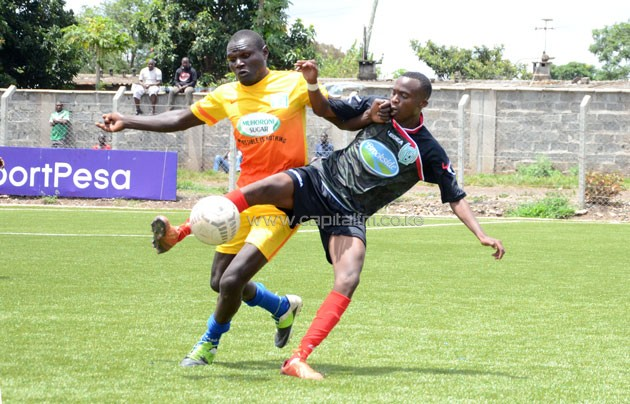 Muhoroni left back Godfrey Masinde vies for the ball with Thika's John Ayire/ PHOTO- Timothy Olobulu