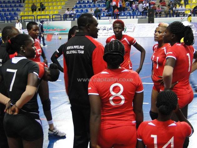 Coach Japheth Munala passes instruction to his girls during one of the breaks/PHOTO-CAVB