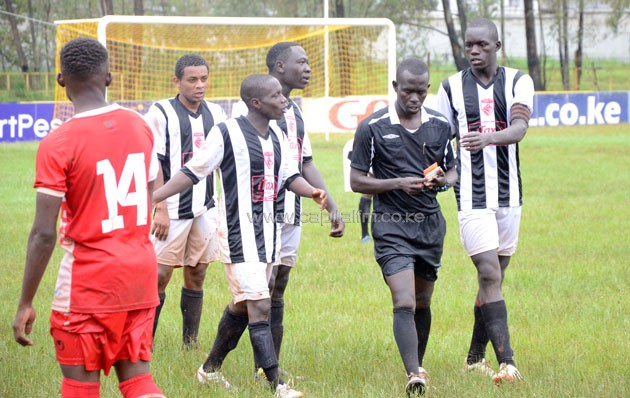 Ushuru FC players protest the sending off of Abdallah Makame/ PHOTO- Timothy Olobulu