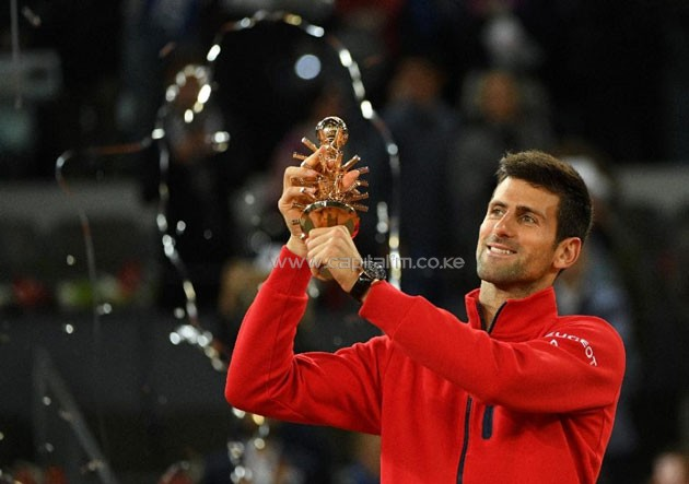 Serbia's Novak Djokovic poses with his trophy as he celebrates his victory over Britain's Andy Murray after the Madrid Open men's tennis final on May 8, 2016 (AFP Photo/Gerard Julien)