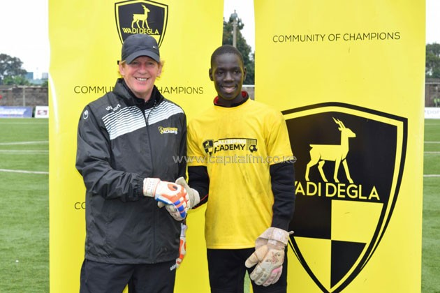 Brian Opiyo being congratulated by Wadi Degla Goalkeeping Academy trainer Maarten Arts.