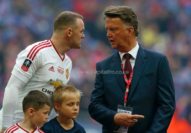Manchester United manager Louis van Gaal (R) speaks with Wayne Rooney before the presentation of the FA Cup trophy at Wembley stadium Manchester United manager Louis van Gaal (R) speaks with Wayne Rooney before the presentation of the FA Cup trophy at Wembley stadium (AFP Photo/Ian Kington)