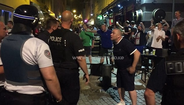 England fans are captured posturing in front of French police in an aggressive style outside an Irish bar. PHOTO/DM.