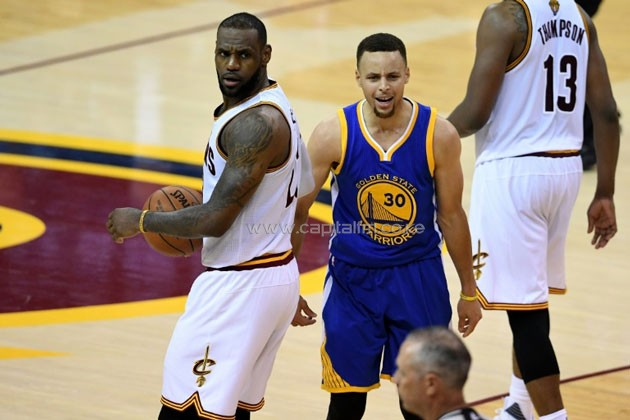 Stephen Curry (R) of the Golden State Warriors reacts to a foul call during the fourth quarter as LeBron James of the Cleveland Cavaliers looks on in Game 6 of the 2016 NBA Finals, at Quicken Loans Arena in Cleveland, Ohio, on June 16.