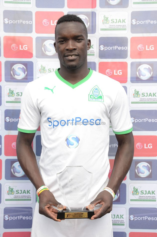 Gor Mahia midfielder Khalid Aucho receiving the Player of the Month Award.PHOTO/Timothy Olobulu.